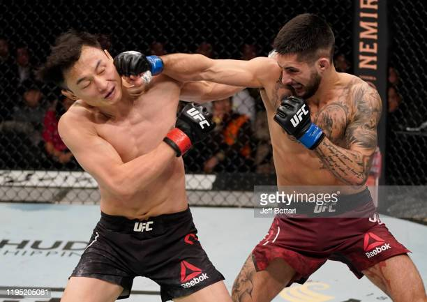 Charles Jourdain of Canada knocks out Dooho Choi of South Korea in their featherweight fight during the UFC Fight Night event at Sajik Arena 3 on...