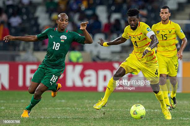 Charles Kabore of Burkina Faso and Emmanuel Adebayor of Togo during the 2013 African Cup of Nations 4th Quarter Final match between Burkina Faso and...