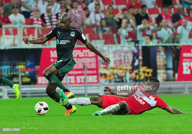 Charles Kabore of FC Krasnodar and Fernando of FC Spartak Moscow vie for the ball during the Russian Premier League match between FC Spartak Moscow...