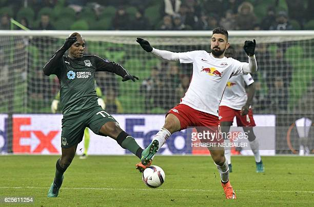 Charles Kabore of FC Krasnodar and Munas Dabbur of FC Salzburg vie for the ball during the UEFA Europa League group I football match between FC...