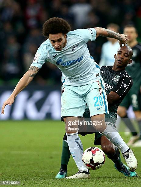 Charles Kabore of FC Krasnodar is challenged by Axel Witsel of FC Zenit St Petersburg during the Russian Premier League match between FC Krasnodar v...