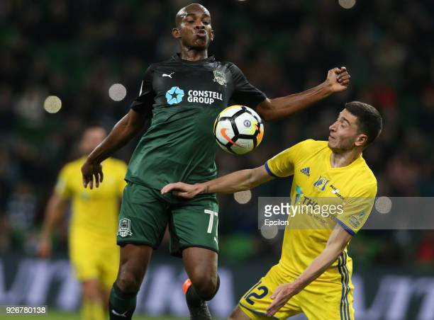 Charles Kabore of FC Krasnodar vies for the ball with Aleksei Ionov of FC Rostov RostovonDon during the Russian Premier League match between FC...