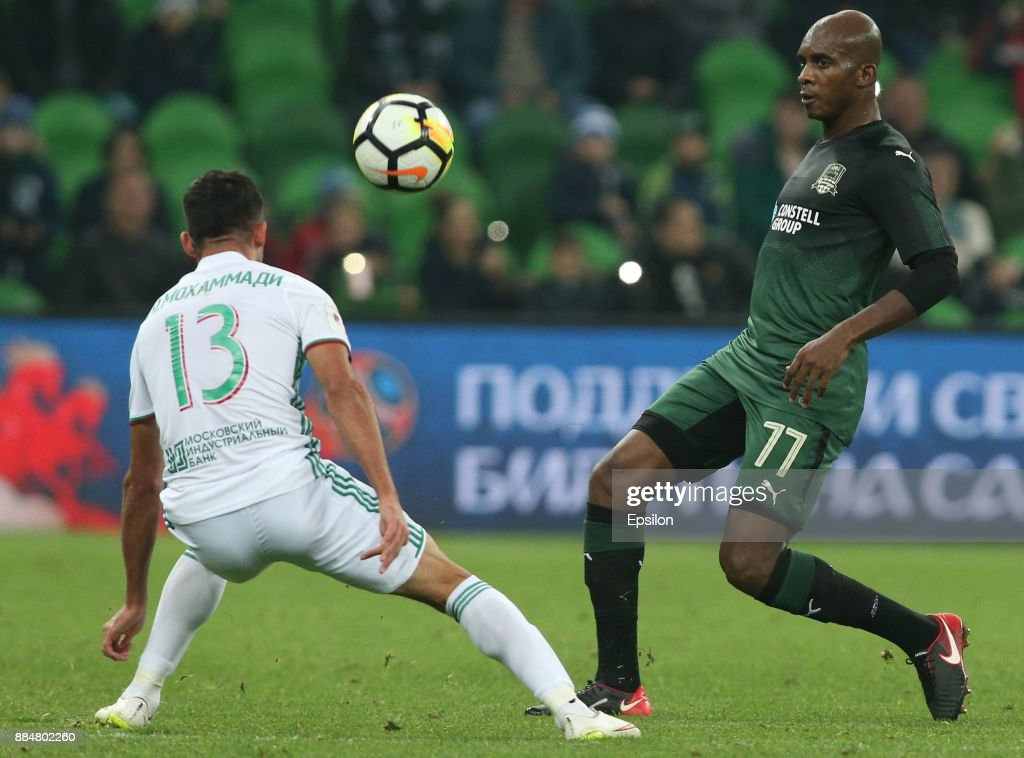 Charles Kabore (R) of FC Krasnodar vies for the ball with Milad Mohammadi of FC Akhmat Grozny during the Russian Premier League match between FC Krasnodar and FC Akhmat Grozny at Krasnodar Stadium on December 03, 2017 in Krasnodar, Russia.