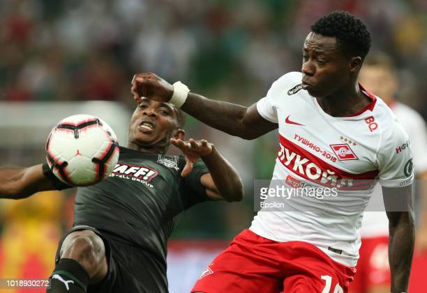 Charles Kabore of FC Krasnodar vies for the ball with Quincy Promes of FC Spartak Moscow during the Russian Premier League match between FC Krasnodar...