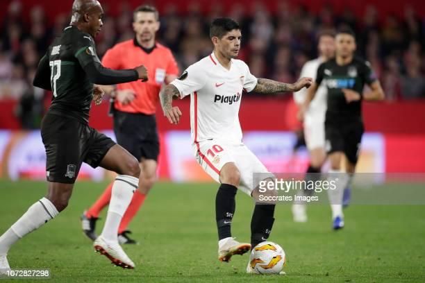 Charles Kabore of Krasnodar Ever Banega of Sevilla FC during the UEFA Europa League match between Sevilla v Krasnodar at the Estadio Ramon Sanchez...