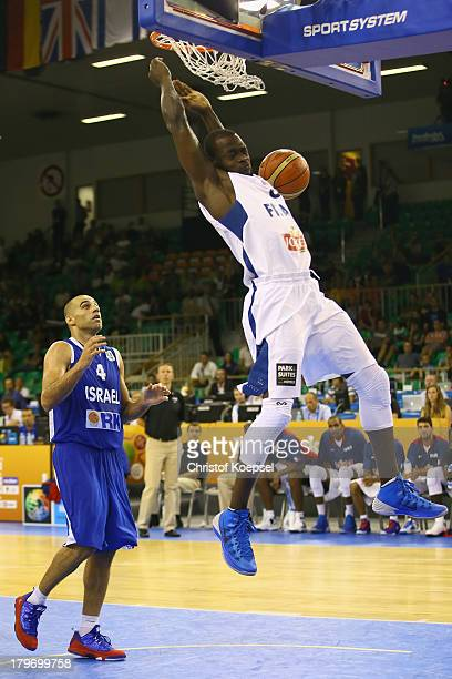 Charles Kahudi of France dunks the ball and Raviv Limonad of Israel watches him during the FIBA European Championships 2013 first round group A match...