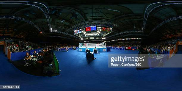 Charles Keama of Papua New Guinea competes against Paddy Barnes of Northern Ireland in the Men's Light Quarter-Final at Scottish Exhibition And...
