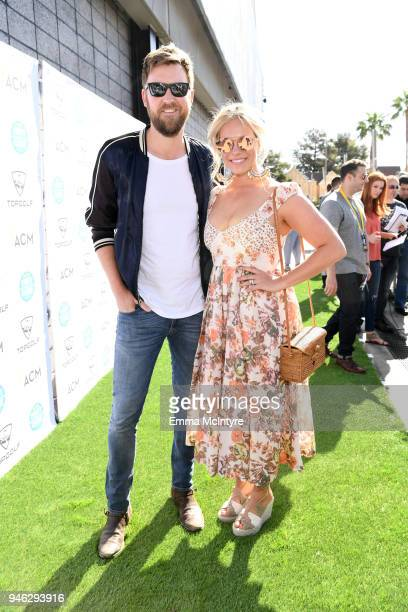 Charles Kelley and Cassie McConnell attend the ACM Lifting Lives TOPGOLF TeeOff at Topgolf Las Vegas on April 14 2018 in Las Vegas Nevada