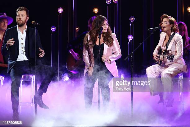 Charles Kelley and Hillary Scott of Lady Antebellum and Halsey perform onstage during the 53rd annual CMA Awards at the Bridgestone Arena on November...