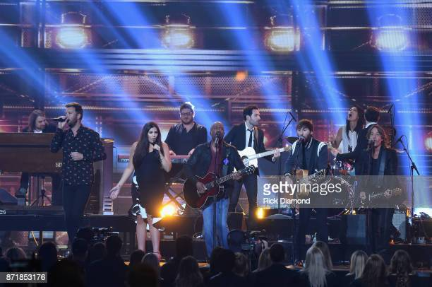 Charles Kelley and Hillary Scott of Lady Antebellum Darius Rucker Dave Haywood of Lady Antebellum and Keith Urban perform onstage at the 51st annual...
