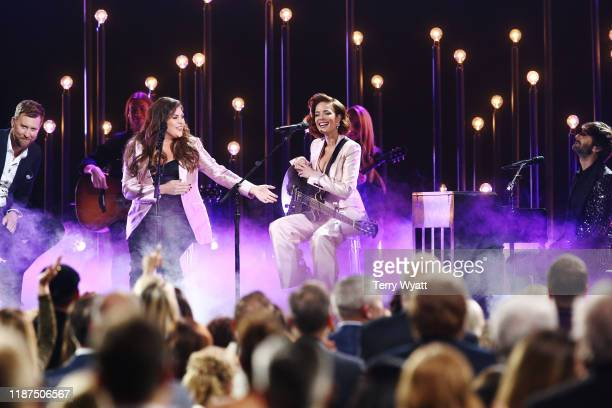 Charles Kelley and Hillary Scott of Lady Antebellum Halsey and Dave Haywood of Lady Antebellum perform onstage during the 53rd annual CMA Awards at...