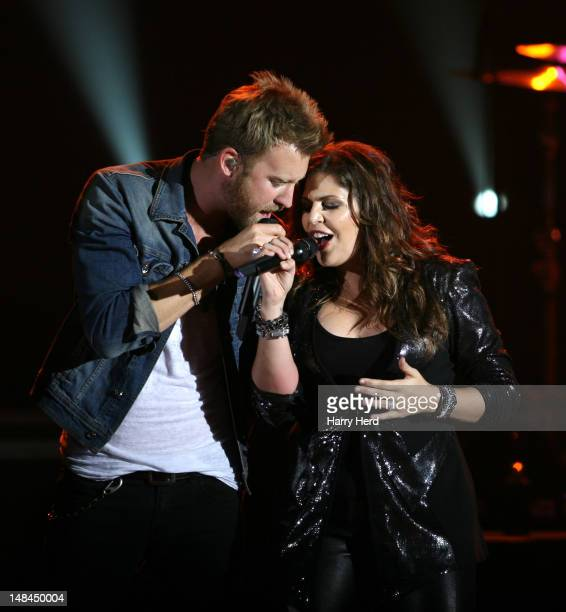 Charles Kelley and Hillary Scott of Lady Antebellum perform at Hammersmith Apollo on July 16 2012 in London England