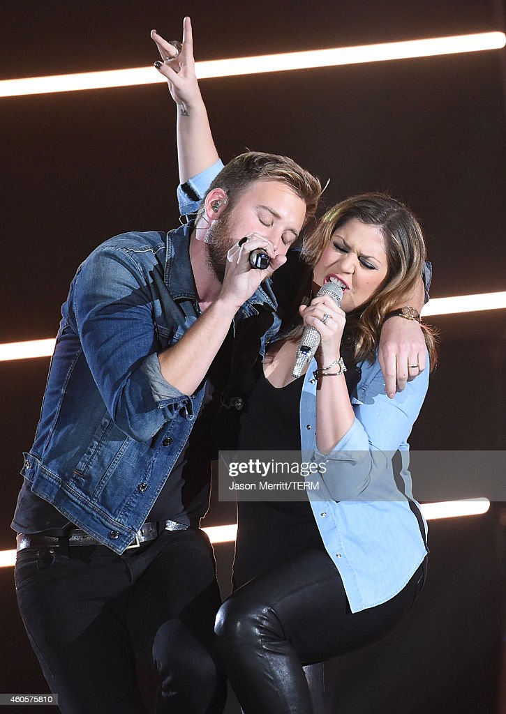 Charles Kelley and Hillary Scott of Lady Antebellum perform at the 2014 American Country Countdown Awards at Music City Center on December 15, 2014 in Nashville, Tennessee.