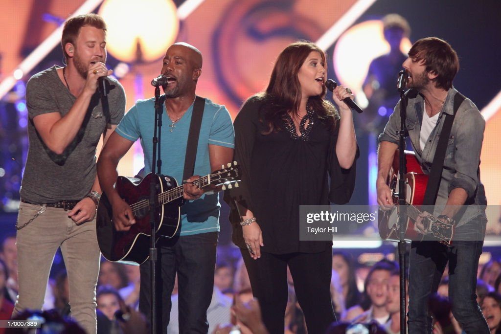 Charles Kelley, Darius Rucker, Hillary Scott, and Dave Haywood perform 'Wagon Wheel' during the 2013 CMT Music awards at the Bridgestone Arena on June 5, 2013 in Nashville, Tennessee.
