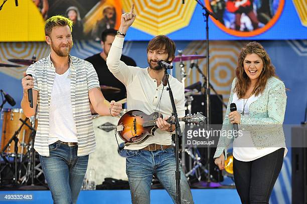 "Charles Kelley, Dave Haywood, and Hillary Scott of Lady Antebellum perform on ABC's ""Good Morning America"" at Rumsey Playfield on May 23, 2014 in New..."