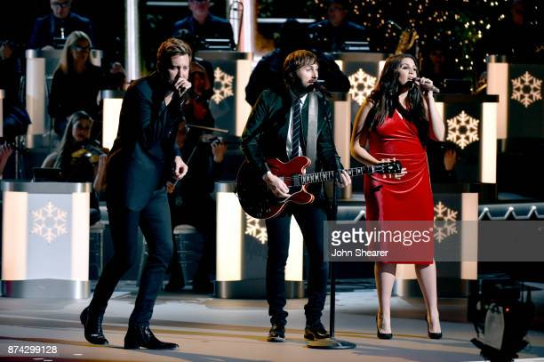 Charles Kelley Dave Haywood and Hillary Scott of Lady Antebellum perform onstage for CMA 2017 Country Christmas at The Grand Ole Opry on November 14...