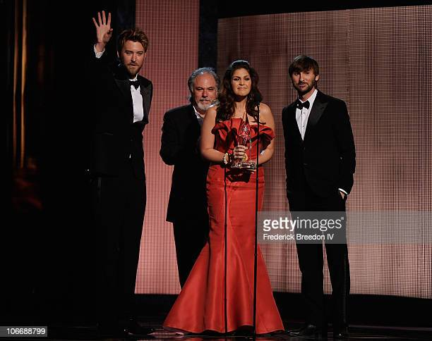 Charles Kelley Hillary Scott and Dave Haywood of Lady Antebellum accept an award onstage at the 44th Annual CMA Awards at the Bridgestone Arena on...