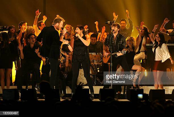 Charles Kelley Hillary Scott and Dave Haywood of Lady Antebellum perform at the 45th annual CMA Awards at the Bridgestone Arena on November 9 2011 in...