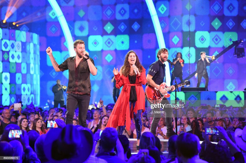 Charles Kelley, Hillary Scott, and Dave Haywood of Lady Antebellum perform onstage at the 2017 CMT Music Awards at the Music City Center on June 7, 2017 in Nashville, Tennessee.
