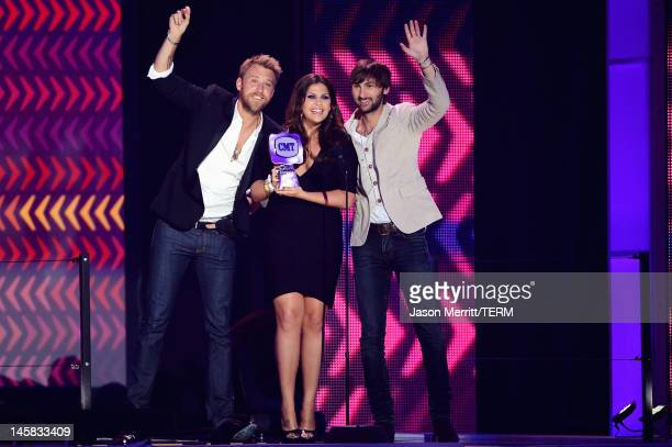 Charles Kelley Hillary Scott and Dave Haywood of Lady Antebellum accept award for Group Video of the Year onstage at the 2012 CMT Music awards at the...