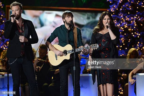 Charles Kelley Hillary Scott and Dave Haywood of Lady Antebellum perform during the CMA 2013 Country Christmas on November 8 2013 in Nashville...