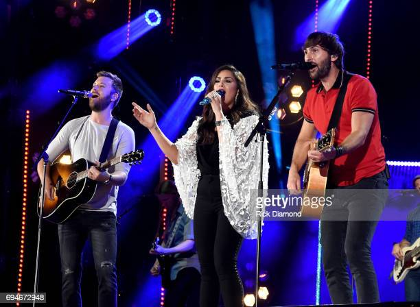 Charles Kelley Hillary Scott and Dave Haywood of Lady Antebellum perform onstage during day 3 of the 2017 CMA Music Festival on June 10 2017 in...