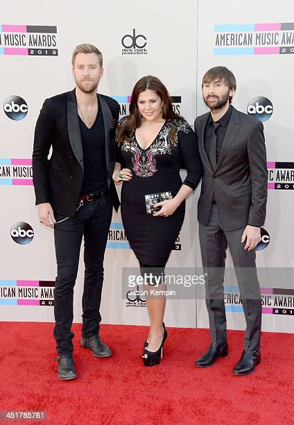 Charles Kelley Hillary Scott and Dave Haywood of Lady Antebellum attend the 2013 American Music Awards at Nokia Theatre LA Live on November 24 2013...