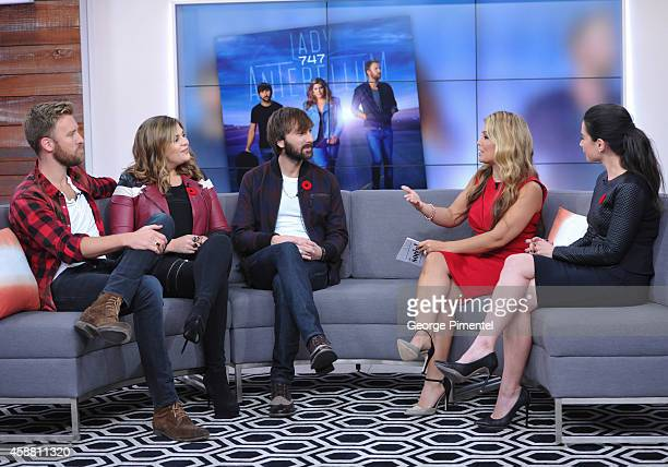 Charles Kelley Hillary Scott Dave Haywood of Lady Antebellum and cohosts Melissa Grelo and Cynthia Loyst appear the The Social on November 11 2014 in...