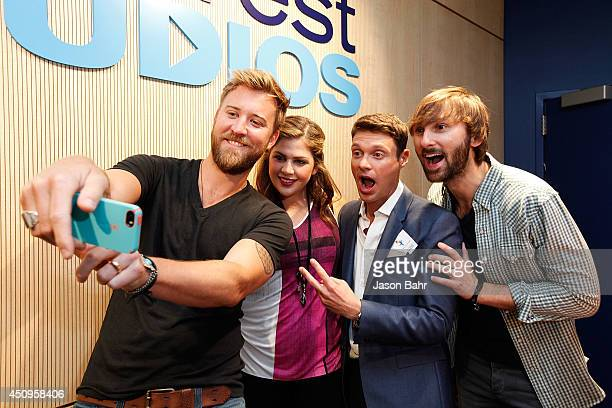 Charles Kelley Hillary Scott Ryan Seacrest and Dave Haywood pose for a self portrait during the grand opening of Seacrest Studios at Children's...