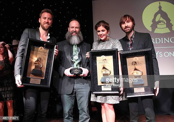 Charles Kelley, music teacher Kent Knappenberger, Hillary Scott, and Dave Haywood pose for a photo with their awards at the GRAMMYs On The Hill 2014...