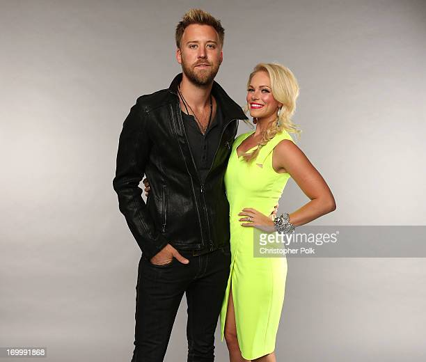 Charles Kelley of the band Lady Antebellum and wife Cassie McConnell pose at the Wonderwall portrait studio during the 2013 CMT Music Awards at...