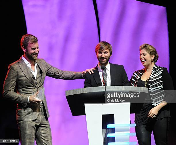 Charles Kelly Dave Haywood and Hillary Scott of Lady Antebellum accept their induction into the 36th annual Georgia Music Hall of Fame at the Georgia...