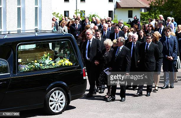 Charles Kennedy's family members including his sister Isobel follow the hearse carrying the coffin of the former Liberal Democrat leader following...