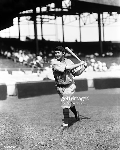 Charles L Hartnett of the Chicago Cubs swinging a bat in 1930