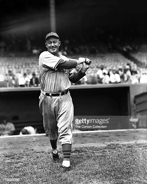 Charles L Hartnett of the Chicago Cubs swinging a bat in 1937
