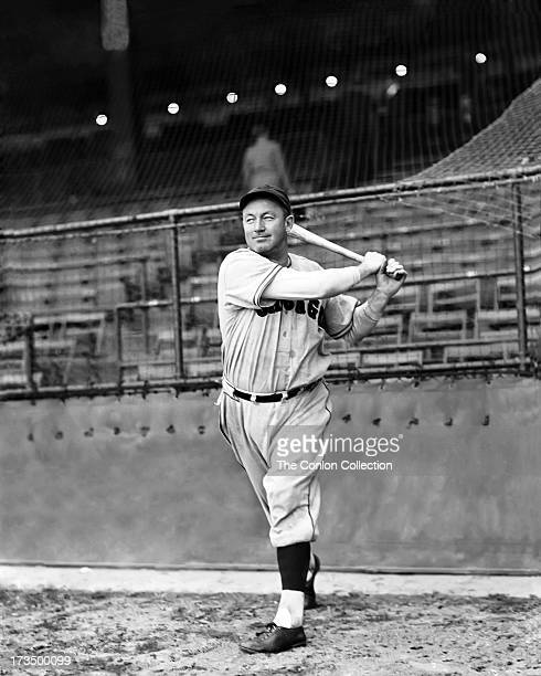 Charles L Hartnett of the Chicago Cubs swinging a bat in 1938