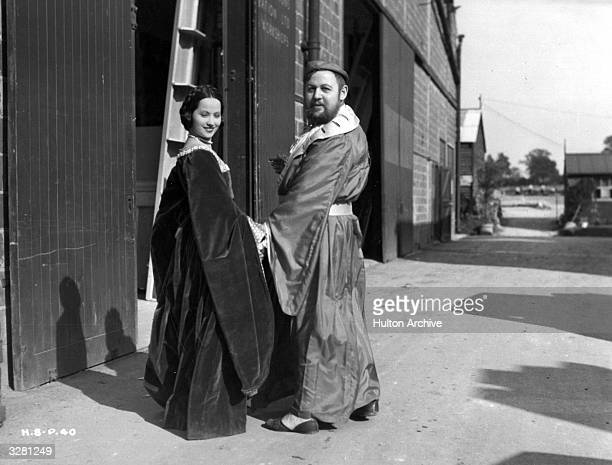 Charles Laughton the British character actor and Merle Oberon formerly Estelle O'Brien Merle Thompson the British leading lady at the studio during...