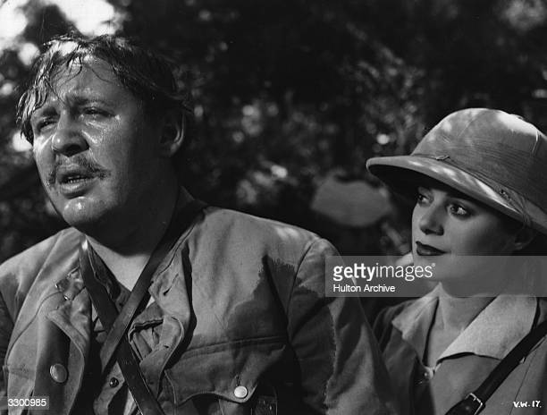 Charles Laughton the character actor and his reallife wife Elsa Lanchester in a scene from the film 'Vessel Of Wrath' aka 'The Beachcomber' directed...