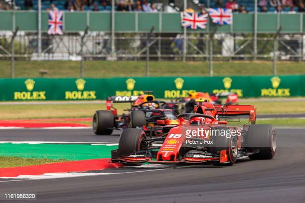 Charles Leclerc of Ferrari and France and Max Verstappen of Red Bull Racing and The Netherlands during the F1 Grand Prix of Great Britain at...