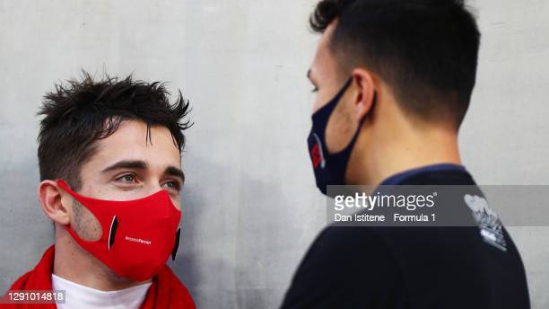Charles Leclerc of Monaco and Ferrari and Alexander Albon of Thailand and Red Bull Racing talk on the grid prior to the F1 Grand Prix of Abu Dhabi at...