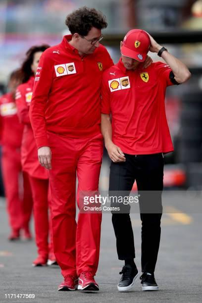Charles Leclerc of Monaco and Ferrari and Ferrari Team Principal Mattia Binotto walk to the Formula 3 grid for a minutes silence in tribute to the...