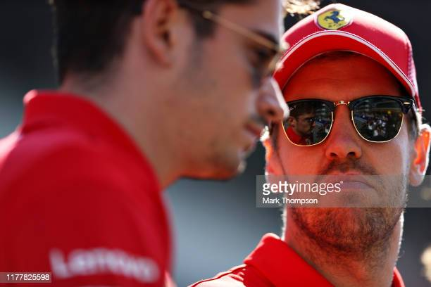 Charles Leclerc of Monaco and Ferrari and Sebastian Vettel of Germany and Ferrari look on on the drivers parade before the F1 Grand Prix of Russia at...