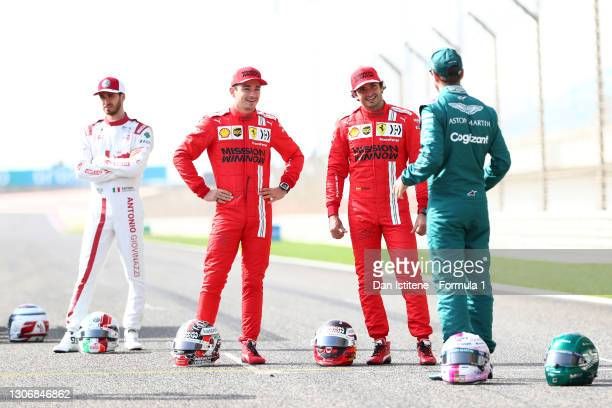 Charles Leclerc of Monaco and Ferrari and team mate Carlos Sainz of Spain and Ferrari laugh with Sebastian Vettel of Germany and Aston Martin F1 on...