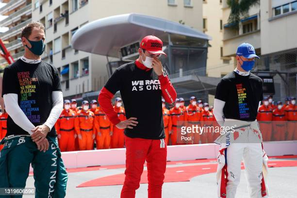 Charles Leclerc of Monaco and Ferrari is pictured standing alongside Sebastian Vettel of Germany and Aston Martin F1 Team and Mick Schumacher of...