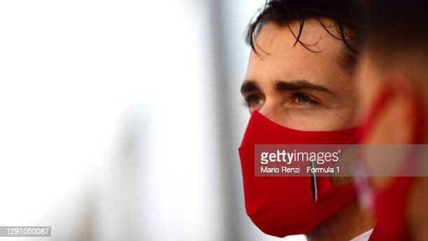 Charles Leclerc of Monaco and Ferrari looks on from the grid prior to the F1 Grand Prix of Abu Dhabi at Yas Marina Circuit on December 13, 2020 in...