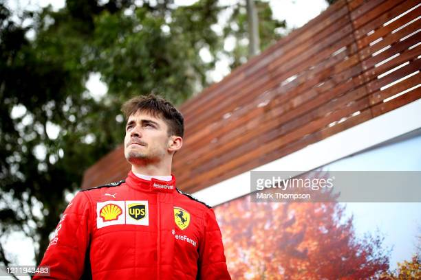 Charles Leclerc of Monaco and Ferrari looks on in the Paddock during previews ahead of the F1 Grand Prix of Australia at Melbourne Grand Prix Circuit...
