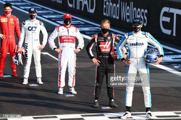 Charles Leclerc of Monaco and Ferrari, Pierre Gasly of France and Scuderia AlphaTauri, Kimi Raikkonen of Finland and Alfa Romeo Racing, Kevin...