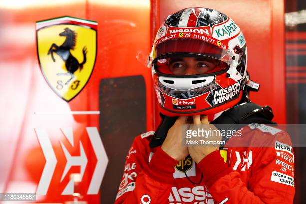 Charles Leclerc of Monaco and Ferrari prepares to drive in the garage during practice for the F1 Grand Prix of Japan at Suzuka Circuit on October 11,...