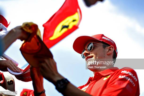 Charles Leclerc of Monaco and Ferrari signs autographs for fans during previews ahead of the F1 Grand Prix of France at Circuit Paul Ricard on June...