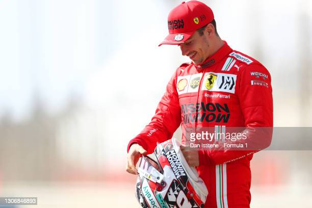 Charles Leclerc of Monaco and Ferrari stands on the grid during Day One of F1 Testing at Bahrain International Circuit on March 12, 2021 in Bahrain,...